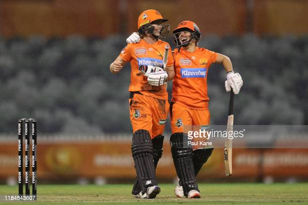 Meg Lanning and Nicole Bolton of the Scorchers celebrate after winning the Women's Big Bash League match between the Perth Scorchers and the...
