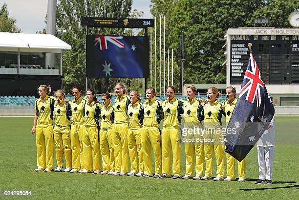 Meg Lanning captain of Australia and her teammates stand for the national anthem during the women's one day international match between the...