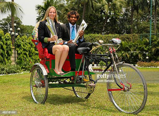 Meg Lanning captain of Australia and Lasith Malinga captain of Sri Lanka poses with the trophies on a rickshaw during a photocall after winning the...