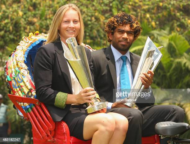 Meg Lanning captain of Australia and Lasith Malinga captain of Sri Lanka pose with the trophies on a rickshaw during a photocall after winning the...