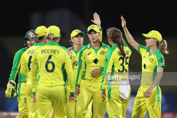 Meg Lanning, captain of Australia and the team celebrate a wicket during game three of the One Day International series between the New Zealand White...