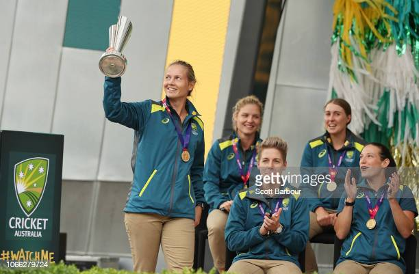 Meg Lanning, captain of Australia brings the World Cup trophy on stage during the Australian Women's T20 Squad Celebration Event at Federation Square...
