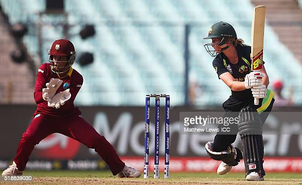 Meg Lanning Captain of Australia hits the ball towards the boundary as Merissa Aguilleira of the West Indies looks on during the Women's ICC World...
