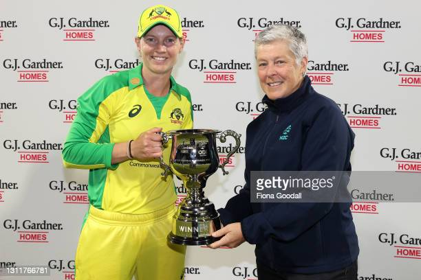 Meg Lanning, captain of Australia is presented with the trophy by Debbie Hockley during game three of the One Day International series between the...