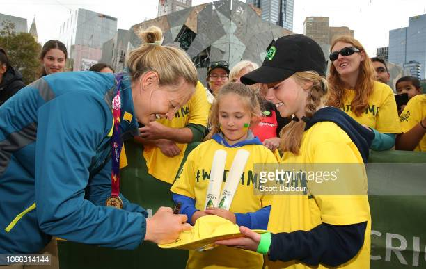 Meg Lanning captain of Australia signs autographs for supporters in the crowd during the Australian Women's T20 Squad Celebration Event at Federation...