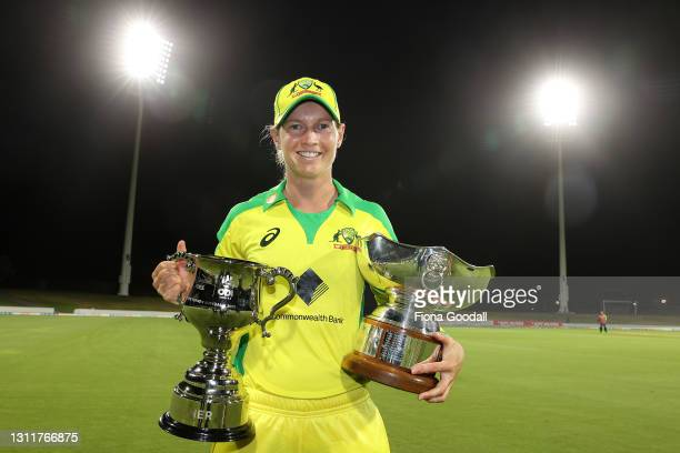 Meg Lanning, captain of Australia with the winning trophies during game three of the One Day International series between the New Zealand White Ferns...