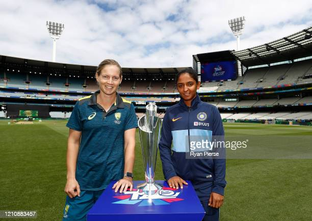 Meg Lanning of Australia and Harmanpreet Kaur of India pose with the trophy during the 2020 ICC Women's T20 World Cup Media Opportunity at Melbourne...