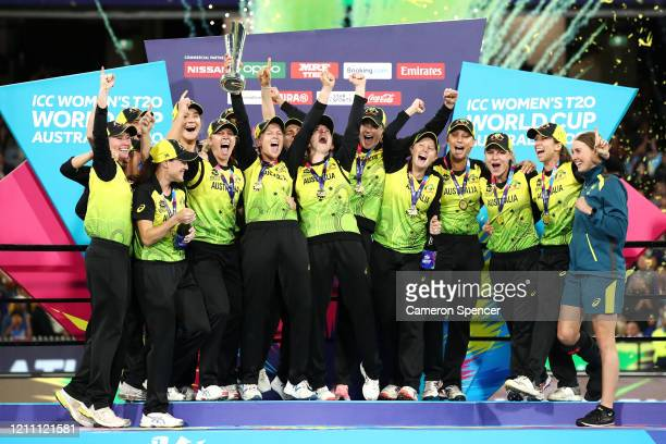 Meg Lanning of Australia and team mates celebrate with the ICC T20 Trophy after winning the ICC Women's T20 Cricket World Cup Final match between...