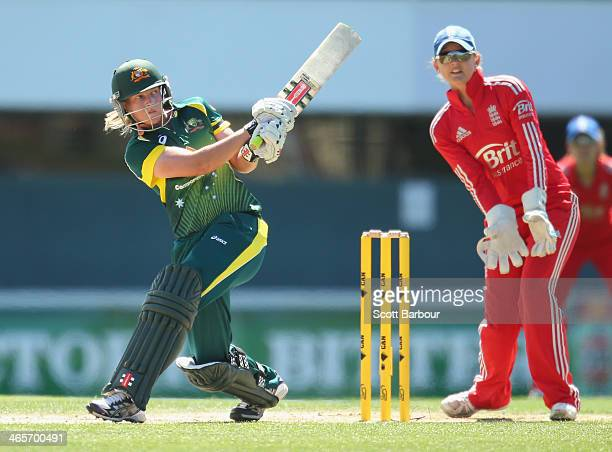Meg Lanning of Australia bats as wicketkeeper Amy Jones of England looks on during game one of the International Twenty20 series between Australia...