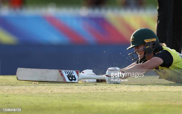 Meg Lanning of Australia celebrates after making her ground to score the winning run during the ICC Women's T20 Cricket World Cup match between...