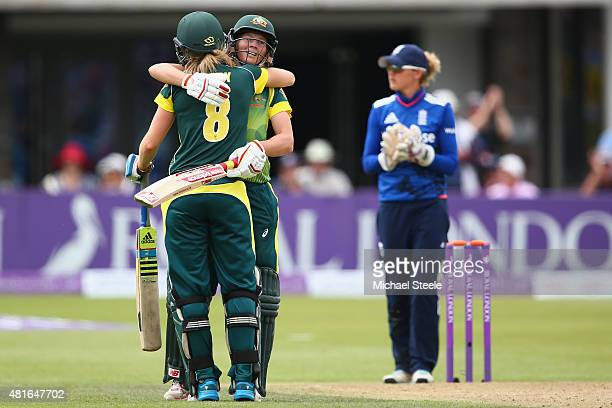 Meg Lanning of Australia celebrates reaching her century with Ellyse Perry during the 2nd Royal London ODI of the Women's Ashes Series between...