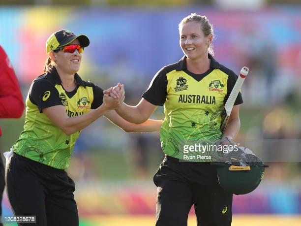 Meg Lanning of Australia celebrates with Megan Schutt of Australia after guiding Australia to the winning runs during the ICC Women's T20 Cricket...
