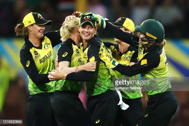 Meg Lanning of Australia celebrates with team mates after catching Mignon du Preez of South Africa off a delivery by Delissa Kimmince of Australia...
