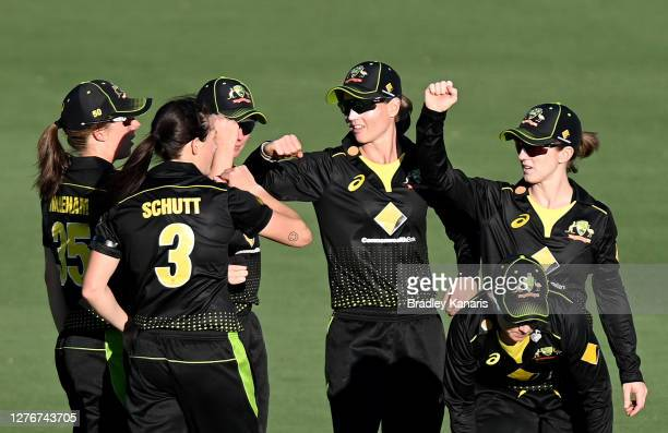 Meg Lanning of Australia celebrates with team mates after taking the wicket of Katey Martin of New Zealand during game one of the T20 Women's...