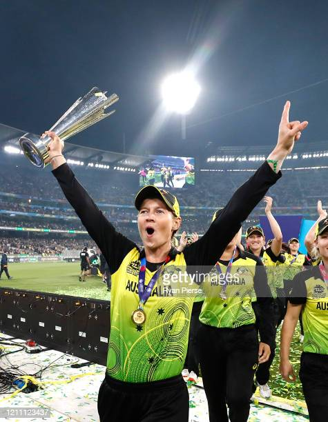 Meg Lanning of Australia celebrates with the World Cup Trophy during the ICC Women's T20 Cricket World Cup Final match between India and Australia at...