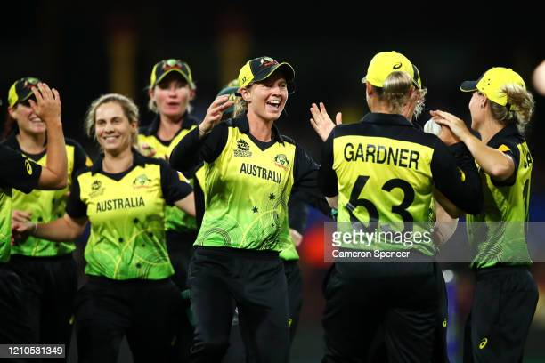 Meg Lanning of Australia congratulates Ashleigh Gardner of Australia after catching Lizelle Lee of South Africa off a delivery by team mate wSophie...