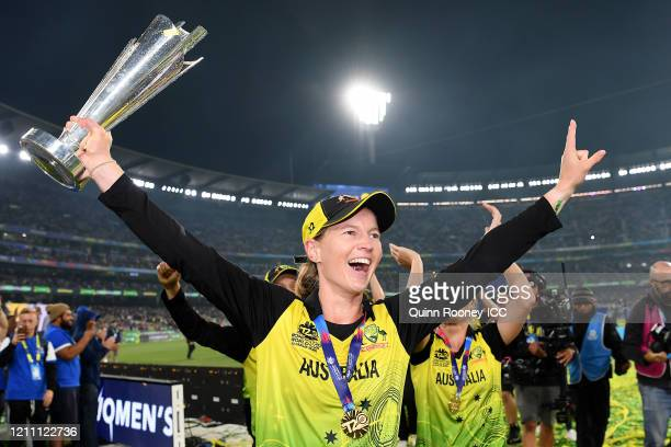 Meg Lanning of Australia holds aloft the championship trophy after winning the ICC Women's T20 Cricket World Cup Final match between India and...
