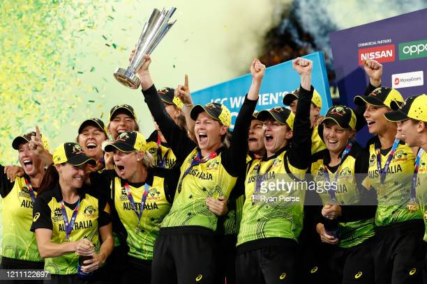 Meg Lanning of Australia holds aloft the championship trophy and celebrates with team mates after winning the ICC Women's T20 Cricket World Cup Final...
