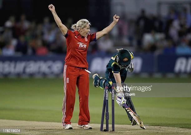 Meg Lanning of Australia is run out as Katherine Brunt of England celebrates during the first NatWest T20 match between England and Australia at the...