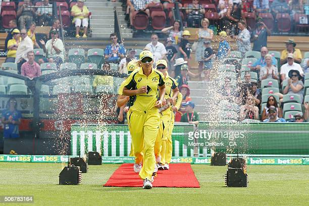 Meg Lanning of Australia leads her team onto the ground during the women's Twenty20 International match between Australia and India at Adelaide Oval...
