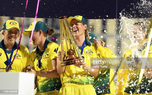 Meg Lanning of Australia lifts the trophy as she celebrates with her team mates during the 3rd Vitality Women's IT20 match between England and...