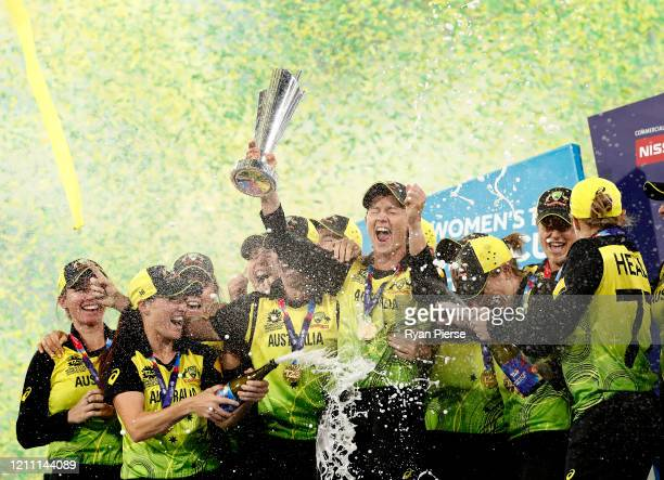 Meg Lanning of Australia lifts the World Cup trophy during the ICC Women's T20 Cricket World Cup Final match between India and Australia at the...