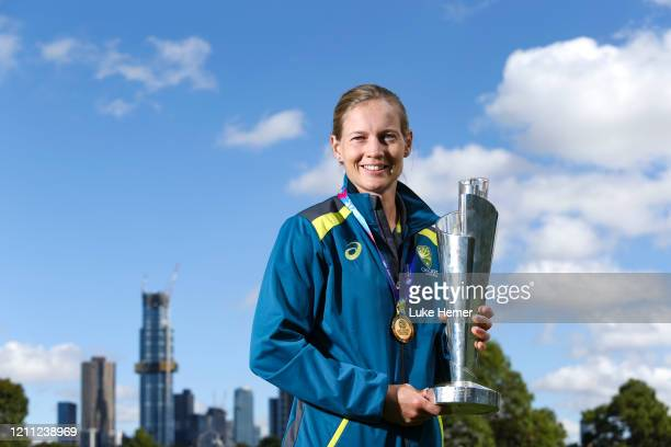 Meg Lanning of Australia poses with the 2020 ICC Women's T20 World Cup trophy after winning the Final at the Royal Botanic Gardens on March 09 2020...
