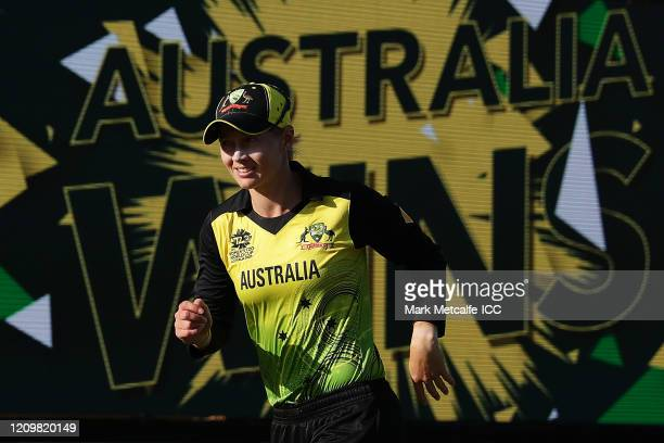 Meg Lanning of Australia runs past a big screen showing Australia win after victory in the ICC Women's T20 Cricket World Cup match between Australia...