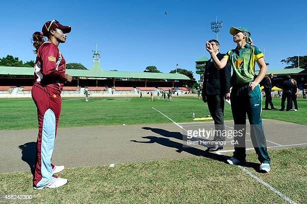 Meg Lanning of Australia tosses the coin during the women's International Twenty20 match between Australia and the West Indies at North Sydney Oval...