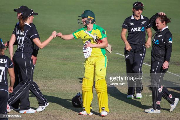 Meg Lanning of the Australia bumps fists with New Zealand players after her team's win during game one in the women's One Day International Series...