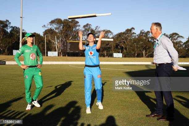 Meg Lanning of the Stars calls as Megan Schutt of the Strikers flips the bat in the bat flip before the Women's Big Bash League WBBL match between...