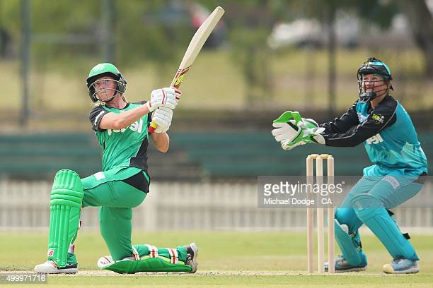 Meg Lanning of the Stars hits the ball for six in front of Beth Mooney of the Heat during the Women's Big Bash League match between the Brisbane Heat...