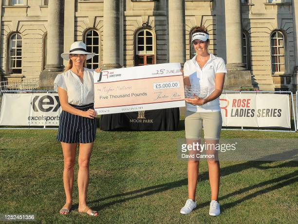 Meg MacLaren of England is presented with the winners Rosebowl by Kate Rose the wife of Justin Rose after her win during The Rose Ladies Series on...