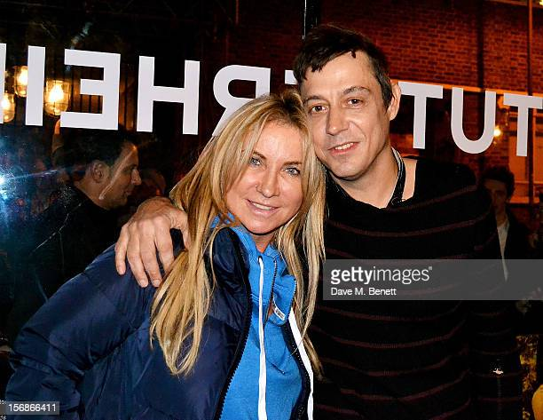 Meg Mathews and Jamie Hince attend the launch of the Stutterheim Raincoats pop up shop in Shoreditch on November 22 2012 in London England
