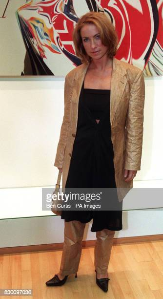 Meg Mathews WIFE OF OASIS STAR NOEL GALLGHER MODELS A PAPER SUIT BY POP ARTIST JAMES ROSENQUIST AT A CHARITY AUCTION OF TWO SIGNED EXAMPLES OF THE...