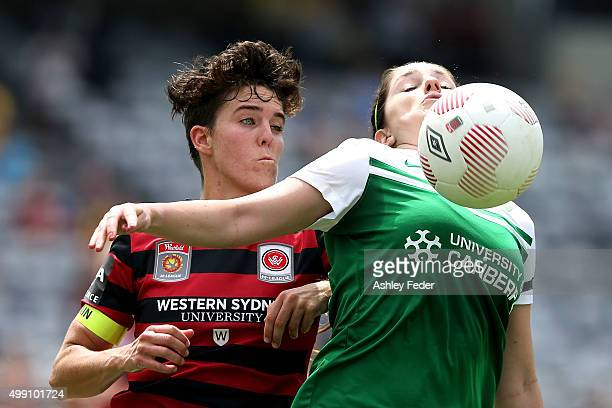 Meg Mclaughlin of Canberra contests the ball against Keelin Winters of the Wanderers during the round seven A-League match between the Western Sydney...