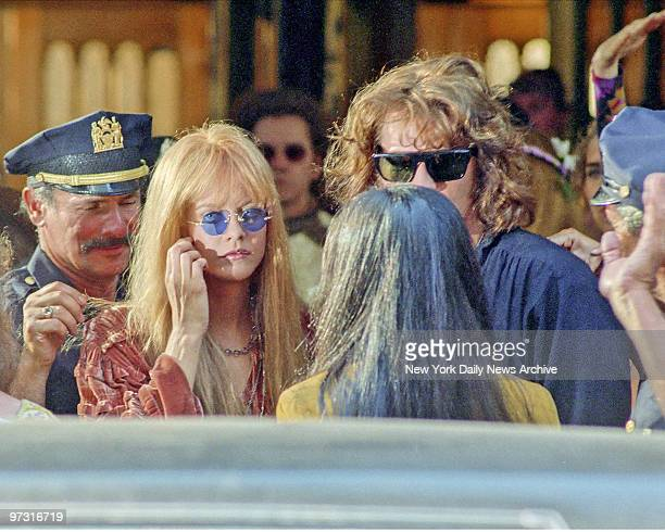 Meg Ryan who plays Pamela Courson Morrison's companion and Val Kilmer as Jim Morrison who star in movie 'The Doors' being filmed in New York