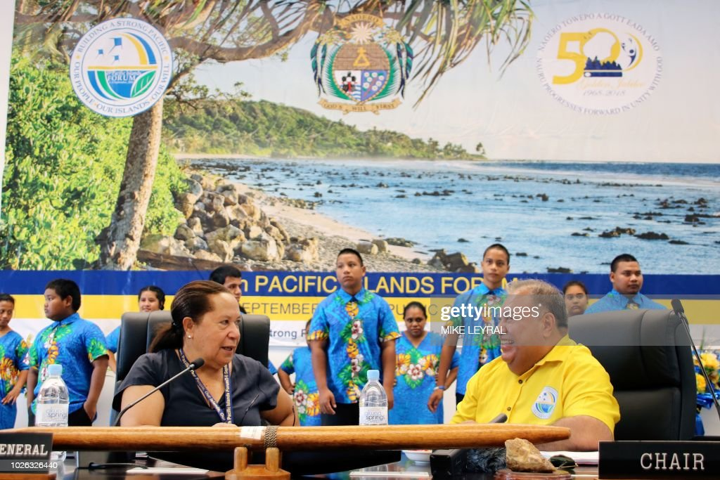 Meg Taylor (L), secretary-general of the PIF, and Nauru's President Baron Waqa (R) attend the 'Small Islands States' meeting ahead of the start of the Pacific Islands Forum (PIF) at the Civic Center in Aiwo on the Pacific island of Nauru on September 3, 2018. - Official talks at the 18-nation Pacific Islands Forum (PIF) starting on September 3 will centre on the threat climate change poses to island states and China's rising influence in the region.
