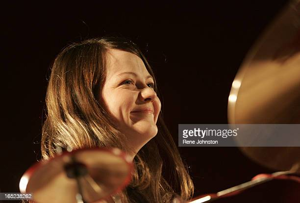Meg White shows a smile between songs as fans cheer for the band. The White Stripes rock Iqaluit in the local hockey arena for a very pleased crowd...