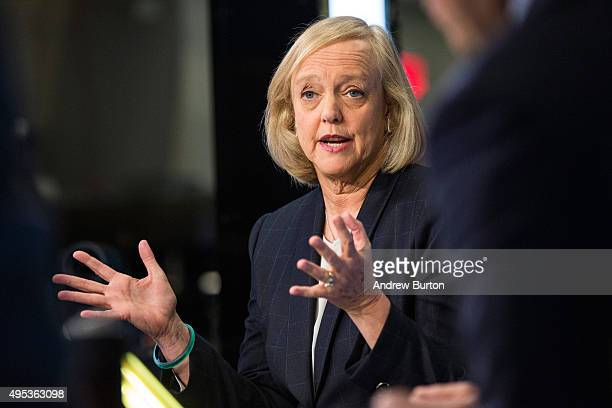 Meg Whitman CEO of Hewlett Packard gives a television interivew on the floor of the New York Stock Exchange after ringing the opening bell on...