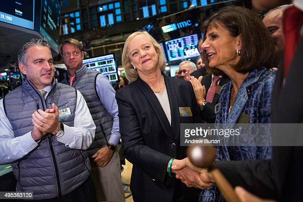 Meg Whitman CEO of Hewlett Packard shakes hands with people after the Hewlett Packard Enterprise stock is priced on the floor of the New York Stock...