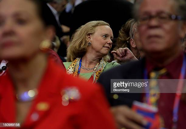 Meg Whitman chief executive officer of HewlettPackard Co center attends the Republican National Convention in Tampa Florida US on Wednesday Aug 29...