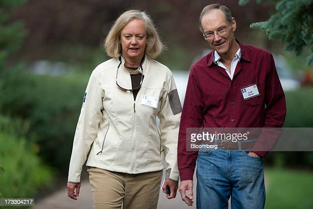 Meg Whitman chief executive officer of HewlettPackard Co walks with her husband Griff Harsh a neurosurgeon while arriving for a morning session...