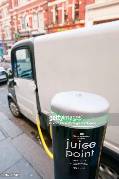A Mega van electric vehicle re charging at a Juice Point electric vehicle charging point in westminster london UK