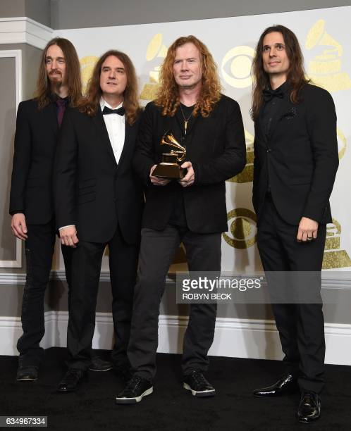 Megadeth poses in the press room with their Grammy for Best Metal Performance for 'Dystopia' during the 59th Grammy Awards at Staples Center on...