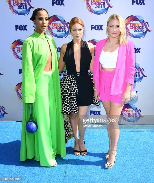 Megalyn Echikunwoke Brittany Snow and Emily Osment arrives at the FOX's Teen Choice Awards 2019 on August 11 2019 in Hermosa Beach California