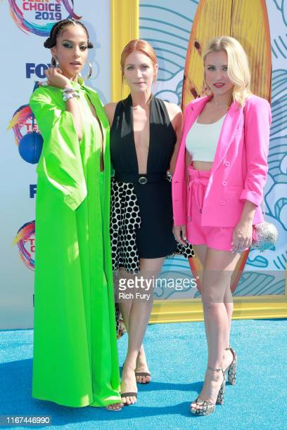 Megalyn Echikunwoke Brittany Snow and Emily Osment attend FOX's Teen Choice Awards 2019 on August 11 2019 in Hermosa Beach California
