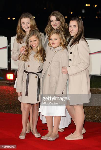 Megan Adams, Florence Ransom, Alice Milburn, Bethany Davey and Charlotte Mellor of the Poppy Girls attend The Sun Military Awards at National...