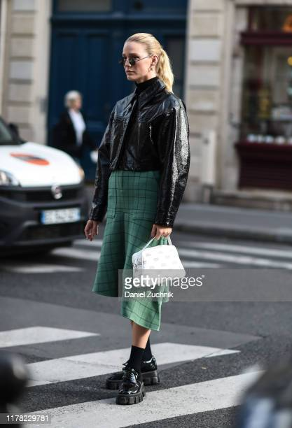 Megan Adelaide is seen wearing an APC black jacket and green skirt outside the APC show during Paris Fashion Week SS20 on September 30, 2019 in...