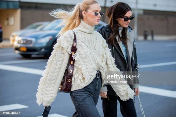 Megan Adelaide Schaefer is seen wearing knit and Madelynn Furlong wearing black leather jacket outside Self-Portrait during New York Fashion Week...